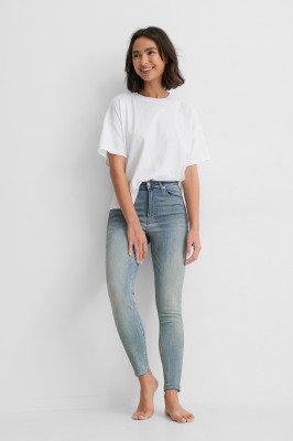 NA-KD Reborn NA-KD Reborn Organisch Skinny Jeans Met Hoge Taille En Ruwe Zoom - Blue